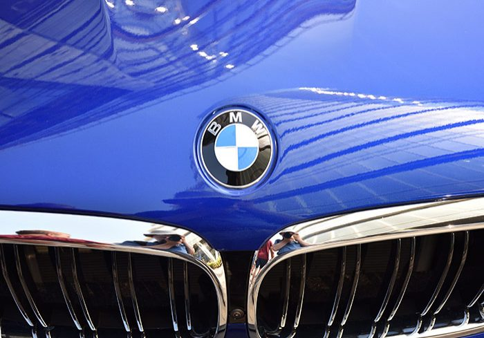 close up of sparkling clean blue bmw car